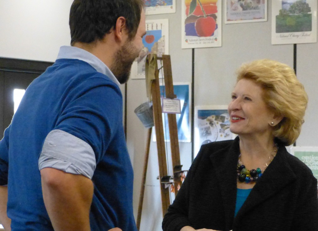 Sen. Debbie Stabenow (D-Mich.) talks with a Michigan farmer. Photo: Ashley Davenport
