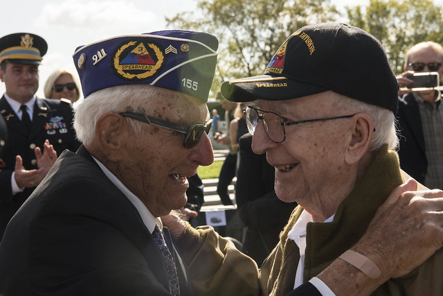 WWII veterans Joe Caserta and Clarence Smoyer embrace each other during the WWII Bronze Star Award Ceremony at the National WWII Memorial, Washington, D.C., Sept. 18, 2019. (DoD photo by U.S. Navy Petty Officer 2nd Class James K. Lee)