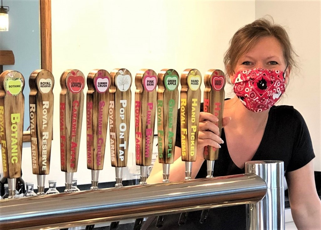 Sara McGuire of Royal Farms Farm Market and Winery in Ellsworth, located in Antrim County, is ready for customers in their tap room. She, along with her staff, are ready for customers with safety measures in place to protect from the spread of COVID-19. Photo, courtesy, Royal Farms, LLC.